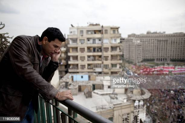 Ayman Mohyeldin the Middle Eastbased correspondent for Al Jazeera English does a live standup from an apartment overlooking Tahrir Square on March 11...