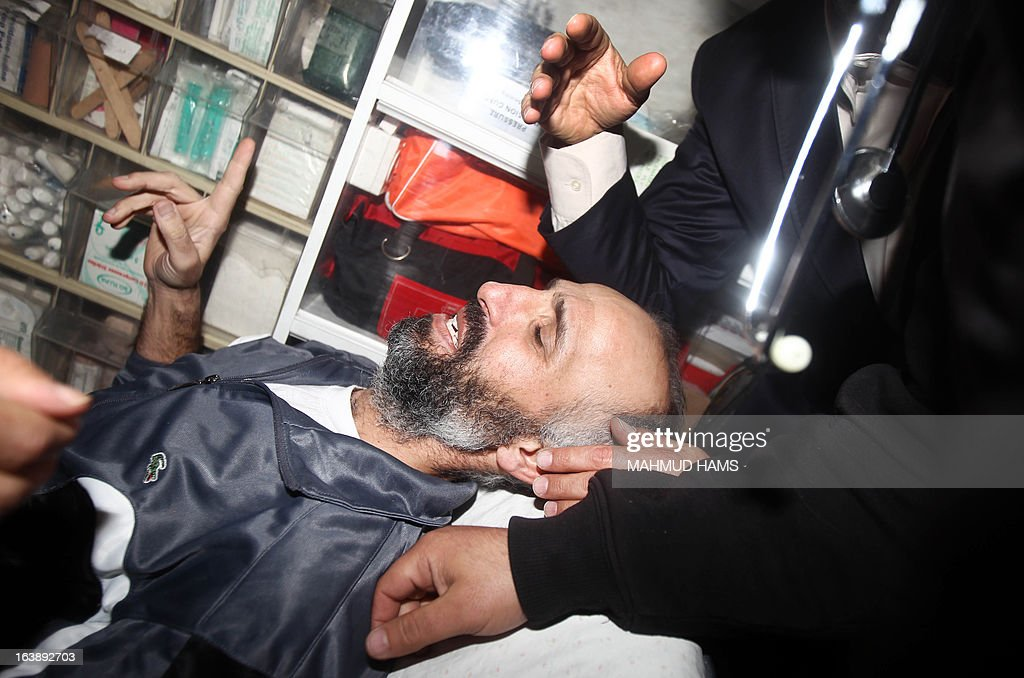 Ayman Sharawna (C), a Palestinian prisoner who was on long-term hunger strike, is pictured inside an ambulance upon his arrival at al-Shifa hospital in Gaza City on March 17, 2013. Sharawna reached a deal under which he was freed from prison but exiled from the West Bank to the Gaza Strip for 10 years.