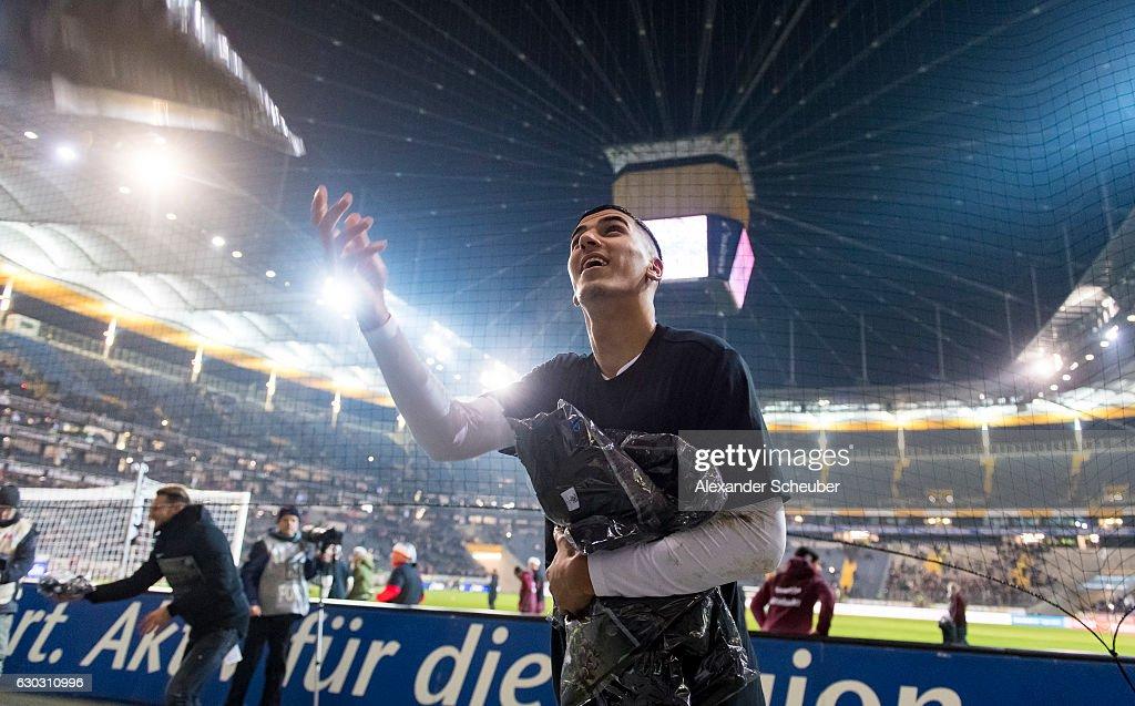 Aymane Barkok of Frankfurt gives away shirts during the Bundesliga match between Eintracht Frankfurt and 1. FSV Mainz 05 at Commerzbank-Arena on December 20, 2016 in Frankfurt am Main, Germany.