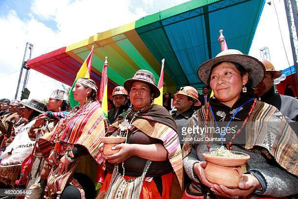 Aymara and Quechua indigenous take part in a parade in La Paz after the swearingin ceremony of Bolivian reelected President Evo Morales for his third...
