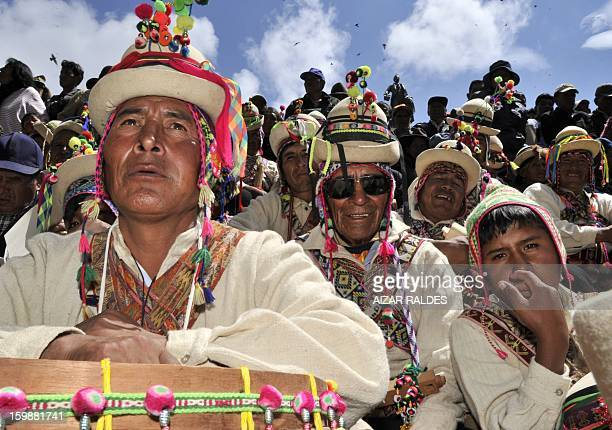 Aymara indigenous peasants attend celebrations for the third anniversary of the Plurinational State of Bolivia outside Quemado palace in La Paz on...