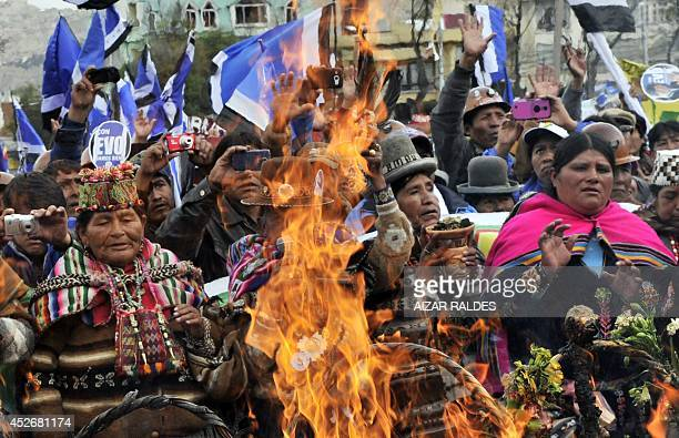 Aymara indigenous people paricipating in President Evo Morales' campaign launching rally ahead of next October's election perform a ritual in La Paz...