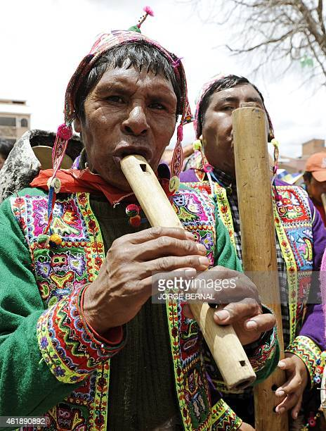 Aymara natives take part in a parade held after a ritual ceremony for reelected Bolivian President Evo Morales along the streets of the town of...