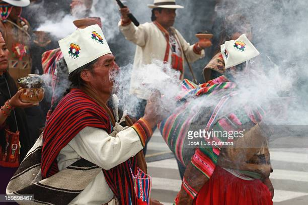 Aymara priests clean the Plaza Murillo with incense during the celebration of the third anniversary of the Plurinational State of Bolivia on January...