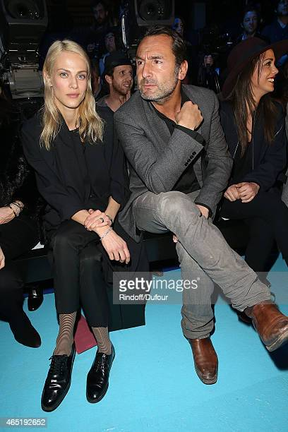 Aymeline Valade and Gilles Lellouche attend The ETAM show as part of the Paris Fashion Week Womenswear Fall/Winter 2015/2016 at Piscine Molitor on...