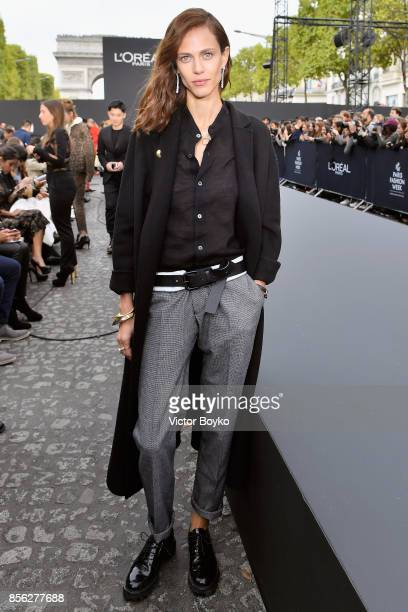 Aymeline Valade attends Le Defile L'Oreal Paris as part of Paris Fashion Week Womenswear Spring/Summer 2018 at Avenue Des Champs Elysees on October 1...