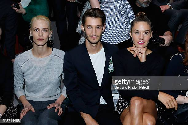 Aymeline Valade Pierre Niney and Natasha Andrews attend the Christian Dior show as part of the Paris Fashion Week Womenswear Fall/Winter 2016/2017 on...