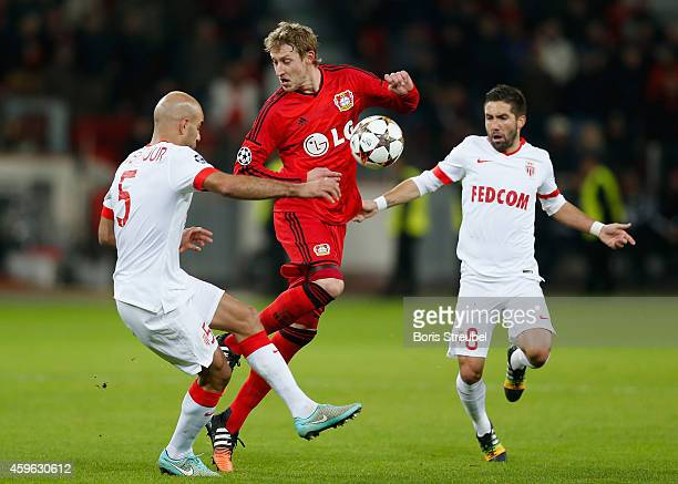 Aymen Abdennour and Joao Moutinho of Monaco challenge Stefan Kiessling of Bayer Leverkusen during the UEFA Champions League group C match between...