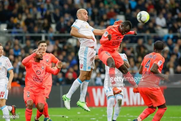 Aymen Abdennour of Marseille and Adama Mbengue of Caen during the Ligue 1 match between Olympique Marseille and SM Caen at Stade Velodrome on...