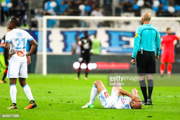 Aymen Abdennour of Marseille is injured during the Ligue 1 match between Olympique Marseille and Stade Rennais at Stade Velodrome on September 10...