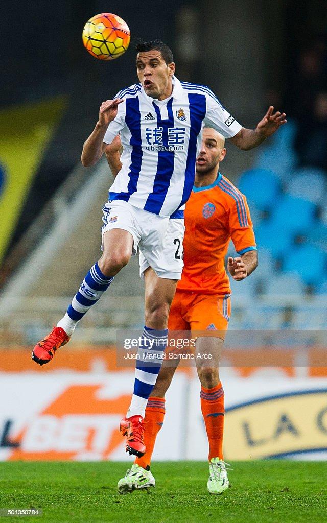 Aymen Abdennour of Valencia CF duels for the ball with Jonathas Cristian de Jesus of Real Sociedad during the La Liga match between Real Sociedad de Futbol and Valencia CF at Estadio Anoeta on January 10, 2016 in San Sebastian, Spain.