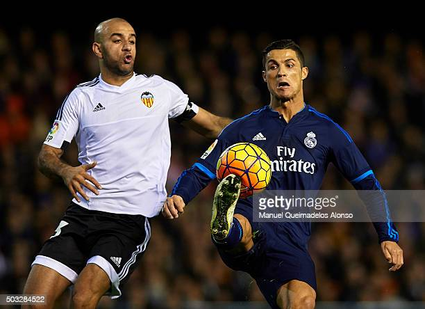 Aymen Abdennour of Valencia competes for the ball with Cristiano Ronaldo of Real Madrid during the La Liga match between Valencia CF and Real Madrid...