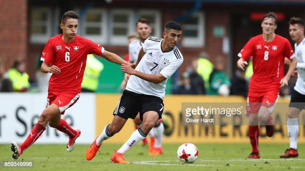 Aymen Barkok of Germany and Eris Abedini of Switzerland compete for the ball during the international friendly U20 match between U20 Germany and U20...