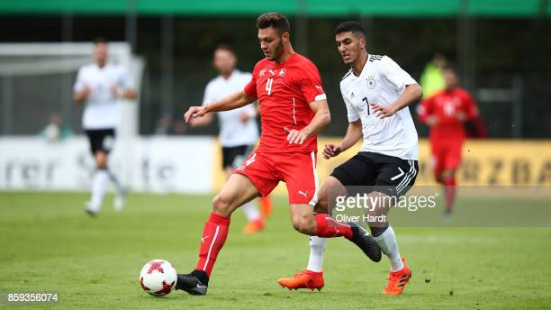 Aymen Barkok of Germany and Samuel Delle Carri of Switzerland compete for the ball during the international friendly U20 match between U20 Germany...