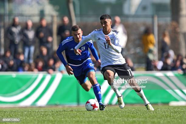 Aymen Barkok of Germany fights for the ball with Marios Andreou of Cyprus during the UEFA Under19 European Championship qualifiers between U19...