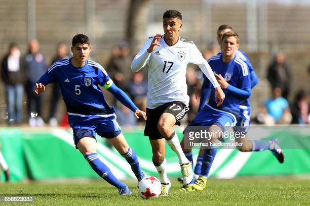 Aymen Barkok of Germany fights for the ball with Panagiotis Artymatas of Cyprus during the UEFA Under19 European Championship qualifiers between U19...