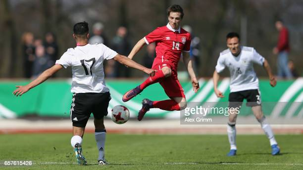 Aymen Barkok of Germany is challenged by Damjan Gojkov of Serbia during the UEFA Elite Round match between U19 Germany and U19 Serbia at Sportpark on...