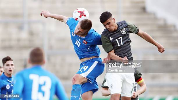 Aymen Barkok of Germany jumps for a header with Daniel Dubec of Slovakiaduring the UEFA Elite Round match between Germany U19 and Slovakia U19 at...