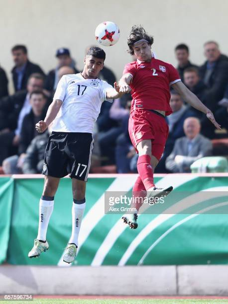 Aymen Barkok of Germany jumps for a header with Sava Radic of Serbia during the UEFA Elite Round match between U19 Germany and U19 Serbia at...