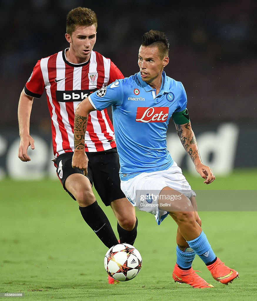 <a gi-track='captionPersonalityLinkClicked' href=/galleries/search?phrase=Aymeric+Laporte&family=editorial&specificpeople=7894319 ng-click='$event.stopPropagation()'>Aymeric Laporte</a> of Athletic Bilbao and Marek Hamsik of Napoli in action during the first leg of UEFA Champions League qualifying play-offs round match between SSC Napoli and Athletic Club on August 19, 2014 in Naples, Italy.