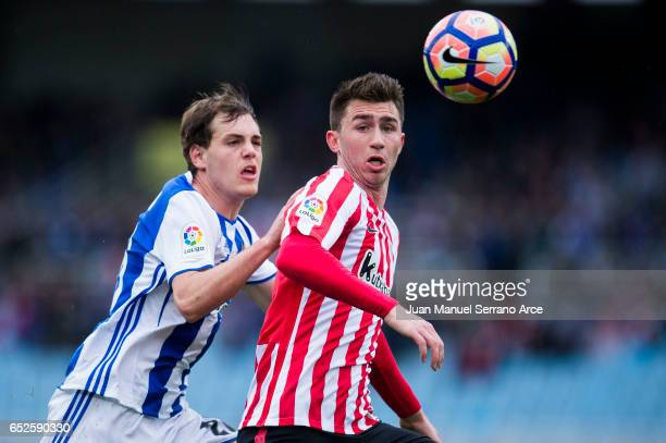 Aymeric Laporte of Athletic Club Bilbao duels for the ball with Jon Bautista of Real Sociedad during the La Liga match between Real Sociedad de...
