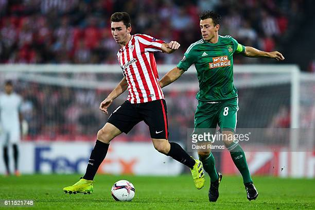Aymeric Laporte of Athletic Club competes for the ball with Stefan Schwab of SK Rapid Wien during the UEFA Europa League Group F match between...