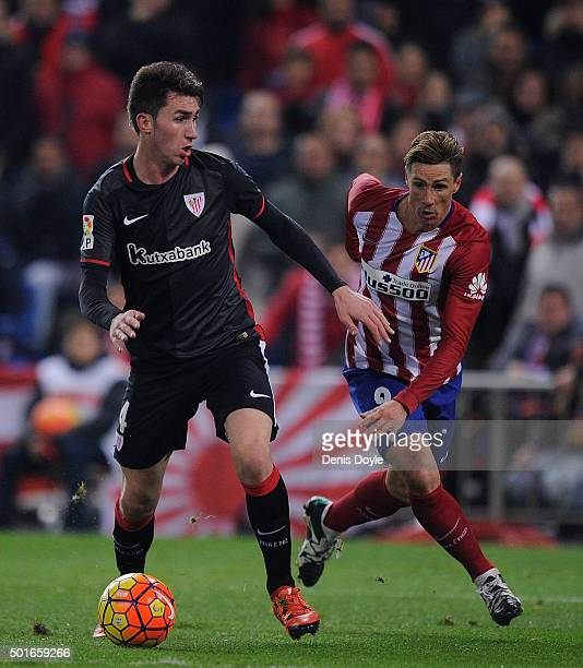 Aymeric Laporte of Athletic Club in action against Fernando Torres of Club Atletico de Madrid during the La Liga match between Club Atletico de...