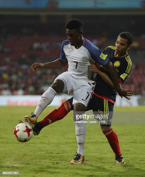 Ayo Akinola of the United States holds off Robert Mejia of Colombia during the FIFA U17 World Cup India 2017 group B match between USA and Colombia...