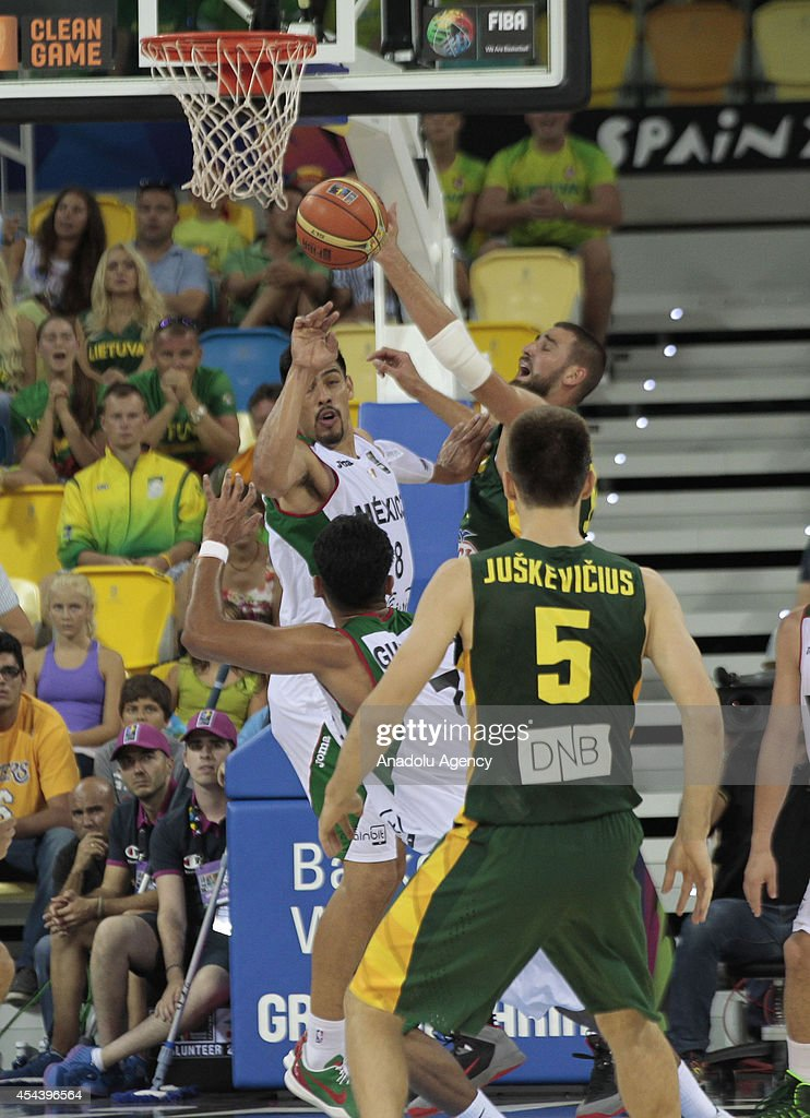 Ayon Gustavo (L) of Mexico in action during the 2014 FIBA World basketball championships group D match between Lithuania vs Mexico at the Gran Canaria Arena in Gran Canaria on August 30, 2014.