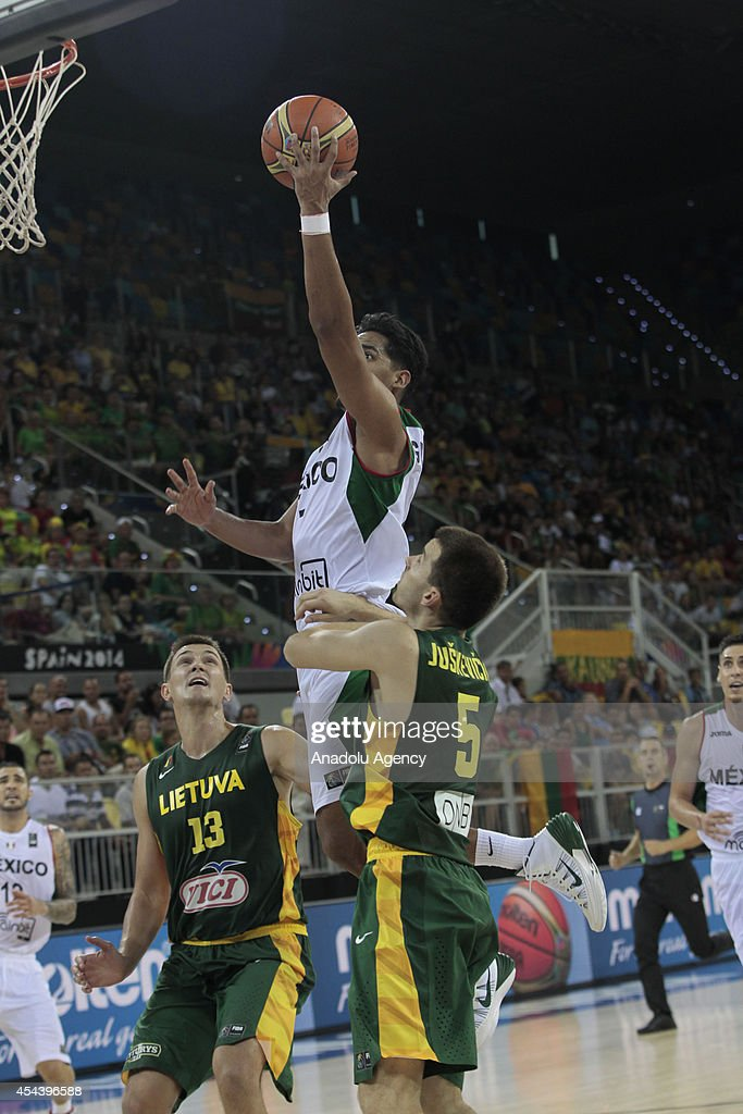 Ayon Gustavo (C) of Mexico in action during the 2014 FIBA World basketball championships group D match between Lithuania vs Mexico at the Gran Canaria Arena in Gran Canaria on August 30, 2014.