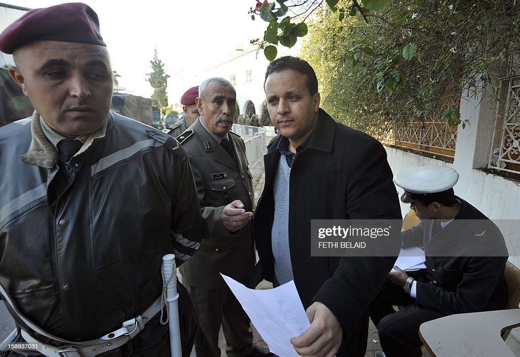 Ayoub Messaoudi (front), former adviser of Tunisian President, arrives for his trial on appeal at a military court on January 4, 2013 in Tunis. Messaoudi, former adviser of Moncef Marzouki, was handed a four-month suspended jail term in September 2012 for defaming the army and 'denigrating a military institution'. AFP PHOTO / FETHI BELAID