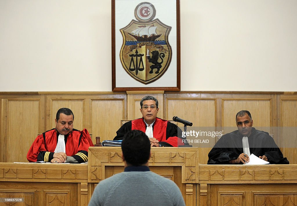Ayoub Messaoudi (front), former adviser of Tunisian President, faces judges during his trial on appeal at a military court on January 4, 2013 in Tunis. Messaoudi, former adviser of Moncef Marzouki, was handed a four-month suspended jail term in September 2012 for defaming the army and 'denigrating a military institution'.