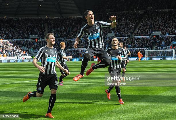 Ayoze Perez of Newcastle celebrates by jumping in the air after scoring the equalising goal during the Barlcays Premier League match between...