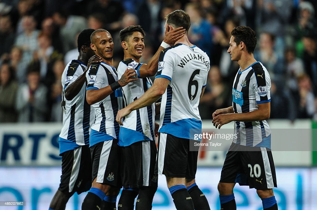 Ayoze Perez (3rd from left) of Newcastle holds Mike Williamson's face and congratulates him after he scores Newcastle's fourth goal during The Capital One Cup second round match between Newcastle United and Northampton Town at St.James Park on August 25, 2015, in Newcastle upon Tyne, England.