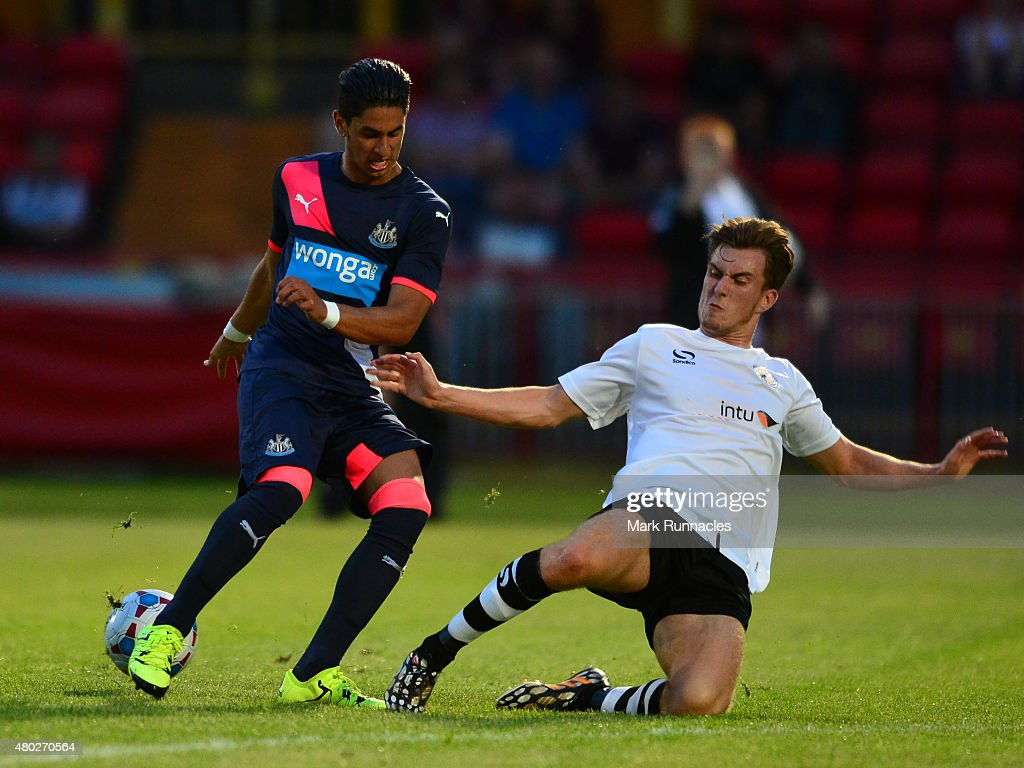 Ayoze Perez of Newcastle is tackled by River Allen of Gateshead during the pre season friendly between Gateshead and Newcastle United at Gateshead...