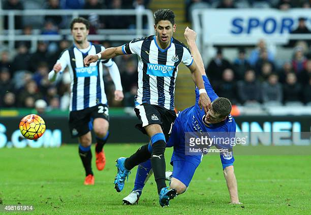 Ayoze Perez of Newcastle is tackled by Robert Huth of Leicester during the Barclays Premier League match between Newcastle United FC and Leicester...