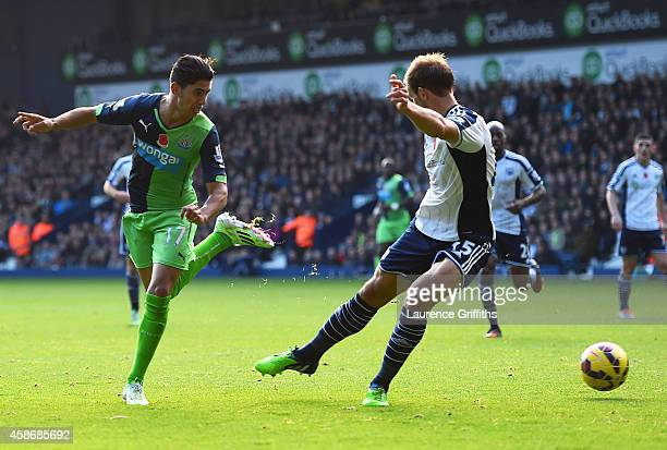 Ayoze Perez of Newcastle United beats Craig Dawson of West Bromwich Albion to score their first goal during the Barclays Premier League match between...