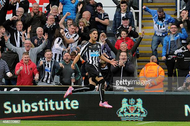 Ayoze Perez of Newcastle United celebrates after scoring the opening goal during the Barclays Premier League match between Newcastle United and...