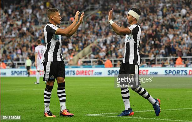 Ayoze Perez of Newcastle United celebrates scoring his team's second goal with Dwight Gayle during the EFL Cup second round match between Newcastle...