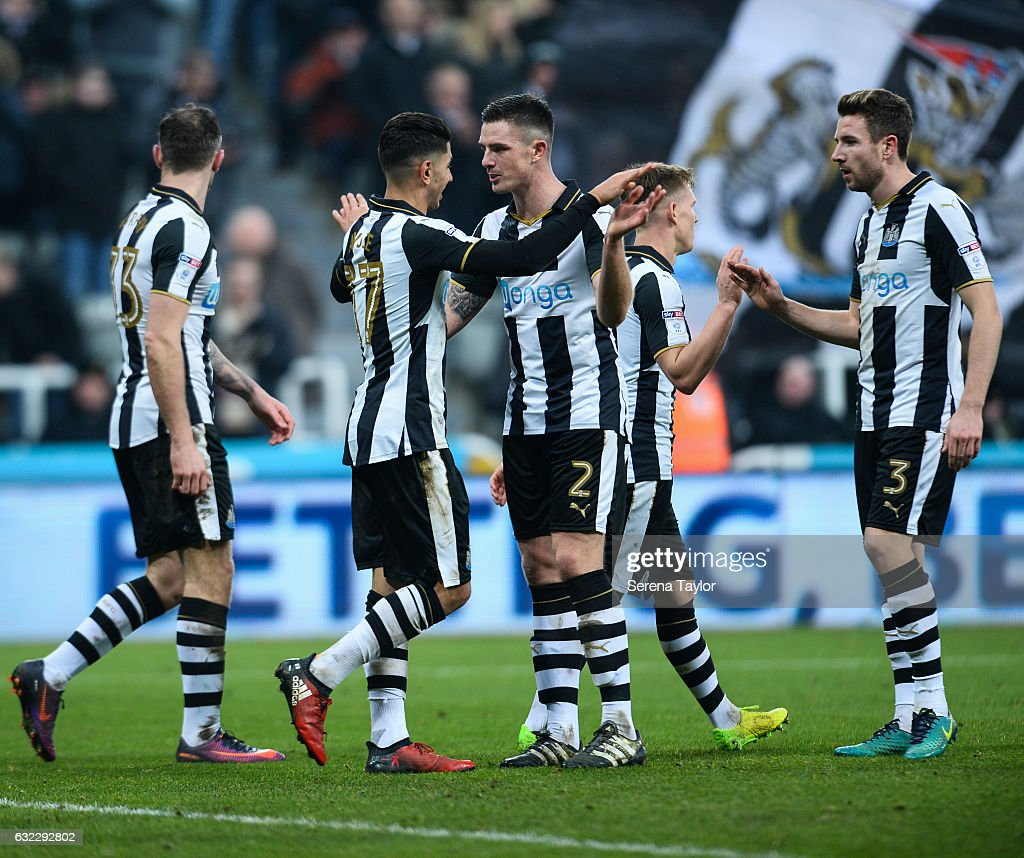 Ayoze Perez of Newcastle United (C) celebrates with teammate Ciaran Clark after scoring the third goal during the Sky Bet Championship match between Newcastle United and Rotherham United at St.James'Park on January 21, 2017 in Newcastle upon Tyne, England.