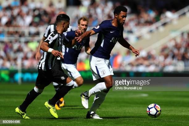 Ayoze Perez of Newcastle United competes with Mousa Dembele of Tottenham Hotspur during the Premier League match between Newcastle United and...