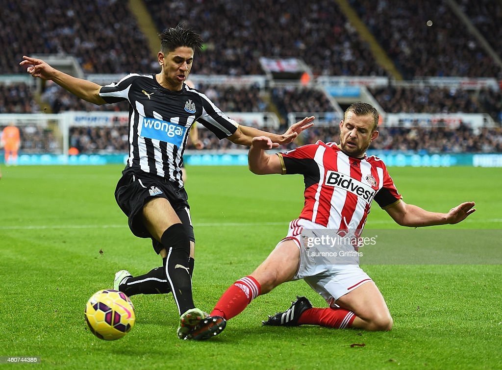 Ayoze Perez of Newcastle United is challenged by Lee Cattermole of Sunderland during the Barclays Premier League match between Newcastle United and...