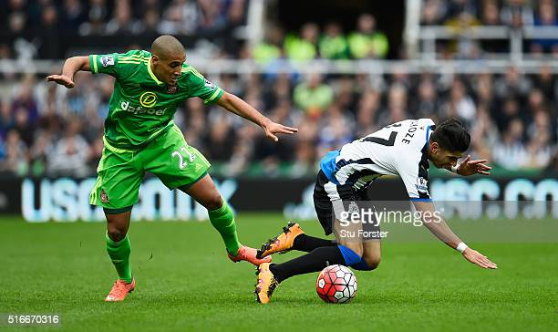 Ayoze Perez of Newcastle United is challenged by Wahbi Khazri of Sunderland during the Barclays Premier League match between Newcastle United and...