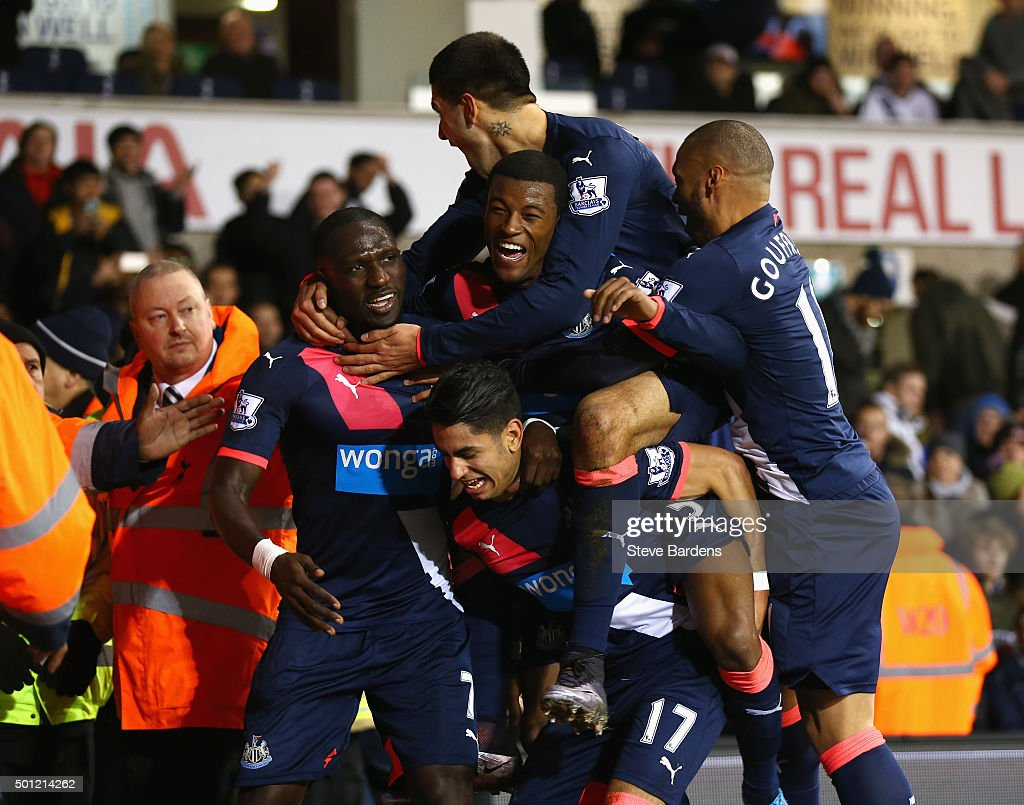 Ayoze Perez of Newcastle United (17) is mobbed in celebration by team mates as he scores their second goal during the Barclays Premier League match between Tottenham Hotspur and Newcastle United at White Hart Lane on December 13, 2015 in London, England.