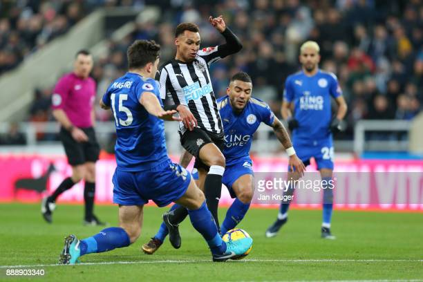 Ayoze Perez of Newcastle United is tackled by Harry Maguire of Leicester City during the Premier League match between Newcastle United and Leicester...