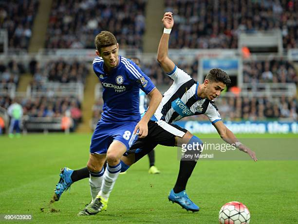 Ayoze Perez of Newcastle United is tackled by Oscar of Chelsea during the Barclays Premier League match between Newcastle United and Chelsea at St...