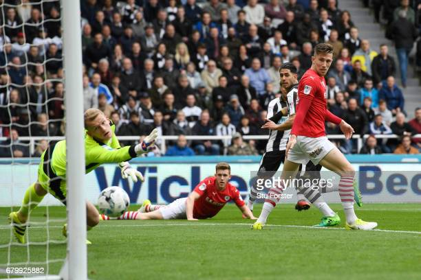 Ayoze Perez of Newcastle United scores his sides first goal past Adam Davies of Barnsley during the Sky Bet Championship match between Newcastle...