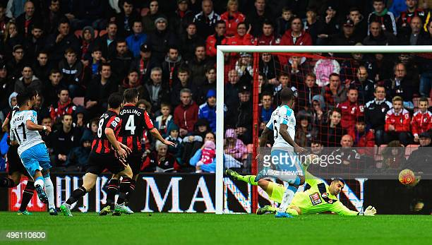 Ayoze Perez of Newcastle United scores his team's first goal past Adam Federici of Bournemouth during the Barclays Premier League match between AFC...