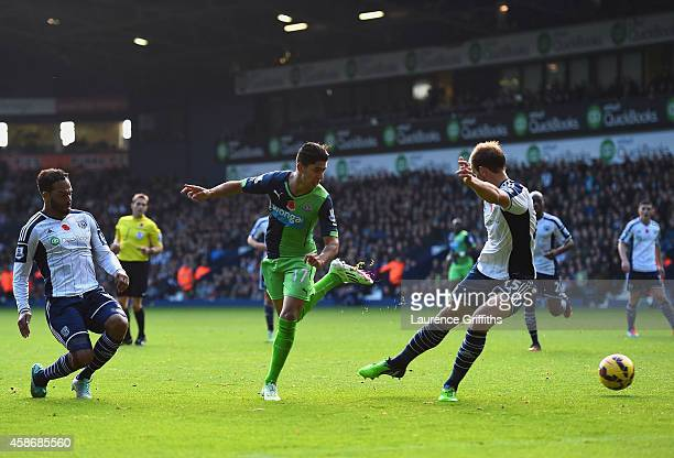 Ayoze Perez of Newcastle United scores their first goal during the Barclays Premier League match between West Bromwich Albion and Newcastle United at...