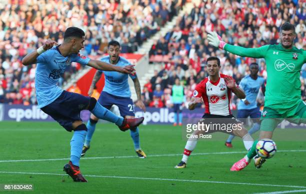 Ayoze Perez of Newcastle United scores their second goal past Fraser Forster of Southampton during the Premier League match between Southampton and...